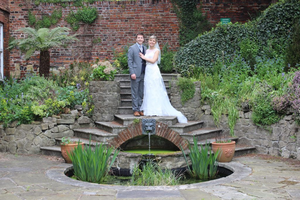 Bride and groom at the pond