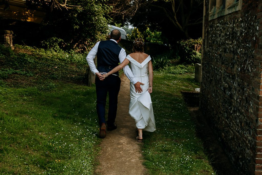 Picture of bride and groom in the church grounds