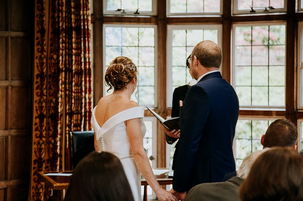 Registrar reading the vows with bride and groom