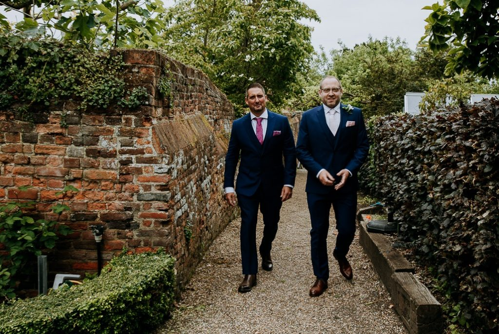 groom and best man making there way to the top lawn