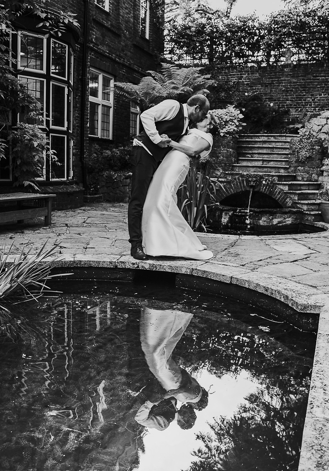 Couple kissing by the pond